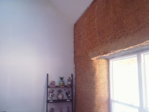 Partially finished wall in strawbale home